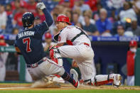 Philadelphia Phillies catcher J.T. Realmuto, right, forces out Atlanta Braves' Dansby Swanson during the second inning of a baseball game Wednesday, June 9, 2021, in Philadelphia. (AP Photo/Chris Szagola)