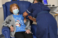 FILE - In this Tuesday Dec. 8, 2020 file photo, 90 year old Margaret Keenan, the first patient in the UK to receive the Pfizer-BioNTech COVID-19 vaccine, administered by nurse May Parsons at University Hospital, Coventry, England. Britain races to vaccinate more than 15 million people by mid-February, and in an effort to ensure vaccines get to the right places at the right times, along with the syringes, alcohol swabs and protective equipment needed to administer them, the government has called in the army. (Jacob King/Pool via AP, File)