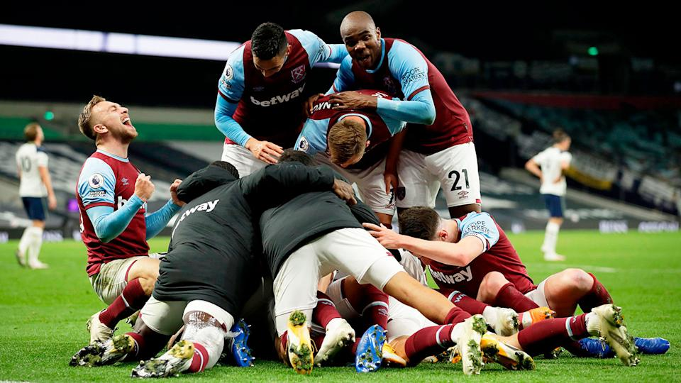 Seen here, West Ham's players celebrate their late equaliser against Spurs.