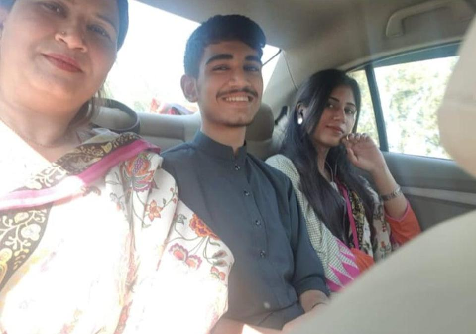 Hassan's siblings, Kainat and Talha Shafiq, are stuck in Pakistan despite their mother (left) being settled in the UK (Supplied)