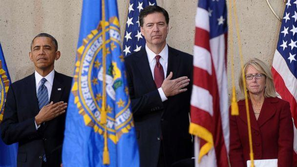 PHOTO: From left, President Barack Obama stands with James Comey and his wife Patrice Failor during the singing of the National Anthem at Comey's installation as FBI Director, Monday, Oct. 28, 2013, at FBI Headquarters in Washington, D.C. (Susan Walsh/AP, FILE)
