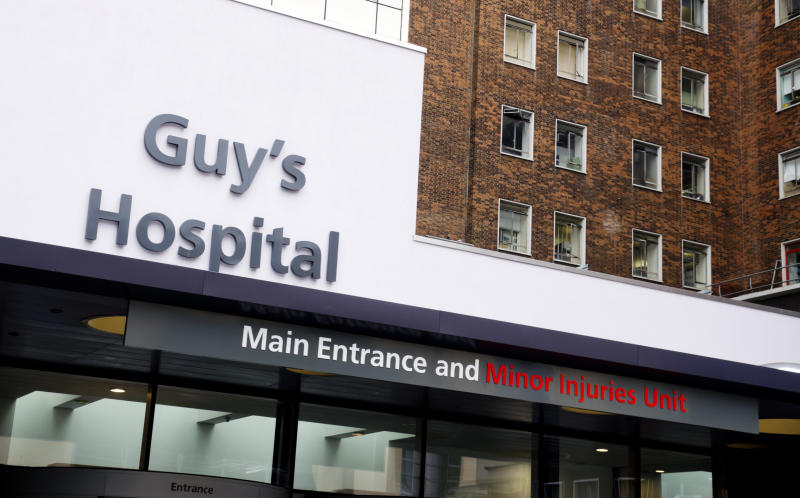 """London, England - May 10, 2012: Main Entrance and Minor Injuries Unit signs at Guy's Hospital, in Southwark, South London. Guy's was founded by Thomas Guy in 1721 as a hospital to treat incurable patients who had been released from the nearby St Thomas' Hospital. It has grown enormously since its foundation and is now merged with St Thomas' to form the Guy's and St Thomas' NHS Foundation Trust. It is one of the most famous hospitals in the UK. (Overcast day.)"""