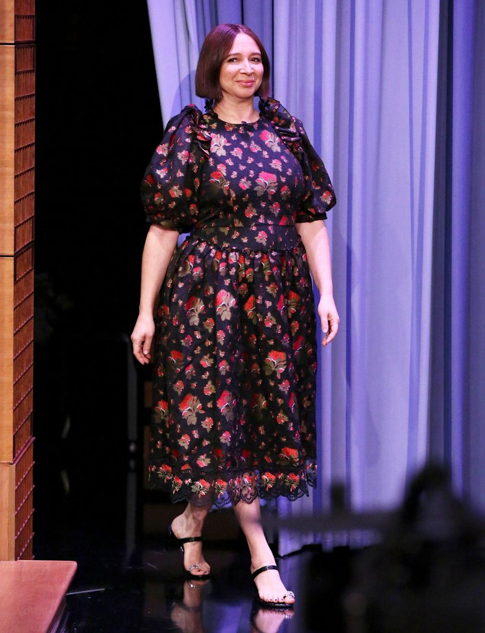 <p>Maya Rudolph makes a grand entrance in a floral dress on Thursday's episode of <i>The Tonight Show Starring Jimmy Fallon</i> in N.Y.C. </p>