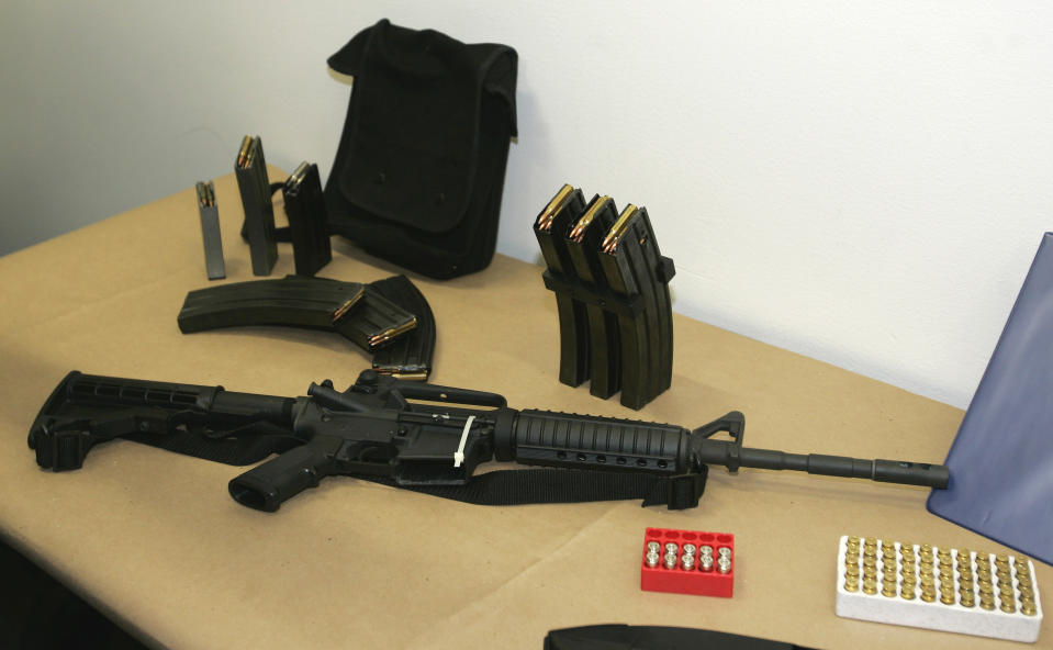 <p> FILE - This March 27, 2006 file photo, shows a Bushmaster AR-15 semi-automatic rifle and ammunition on display at the Seattle Police headquarters in Seattle. The maker of the Bushmaster rapid-fire weapon used to kill schoolchildren in Connecticut on Friday, Dec. 14, 2012, was put up for sale on Tuesday, Dec. 18, 2012, as investors soured on the gun business. (AP Photo/Ted S. Warren, File) </p>