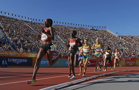 Athletics - Gold Coast 2018 Commonwealth Games - Women's 5000m - Final - Carrara Stadium - Gold Coast, Australia - April 14, 2018. Hellen Obiri of Kenya leads the pack. REUTERS/Paul Childs