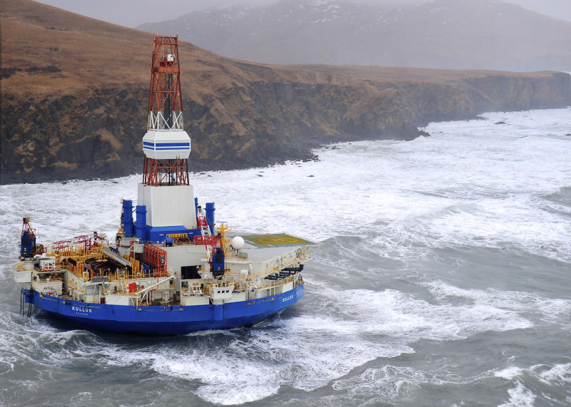 This aerial image provided by the U.S. Coast Guard shows the Royal Dutch Shell drilling rig Kulluk aground off a small island near Kodiak Island Tuesday, Jan. 1, 2013. No leak has been seen from the drilling ship that grounded off the island during a storm, officials said, as opponents criticized the growing race to explore the Arctic for energy resources. (AP Photo/U.S. Coast Guard)