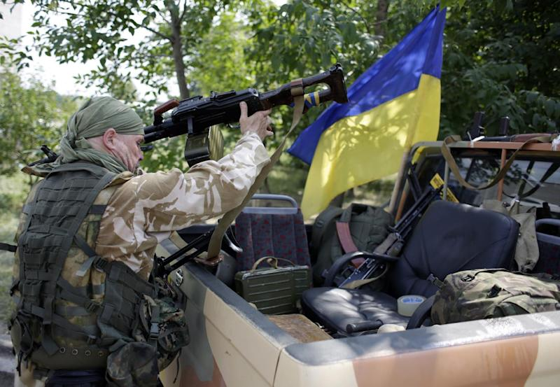 A Ukrainian serviceman from the Donbass volunteer battalion prepares for redeployment on August 4, 2014 from Popasna, Lugansk region, freed by Ukrainian forces from the pro-Russian militants, to Donetsk (AFP Photo/Anatolii Stepanov)
