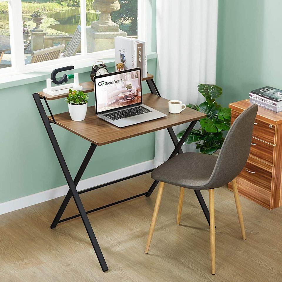 <p>If you work hard and play hard, you're going to love this <span>GreenForest 2-Tier Folding Desk</span> ($70, originally $80). It's a two-tiered small computer desk that can be folded and stored away when not in use. It requires no assembly. </p>