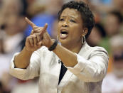 FILE - In this June 28, 2011, file photo, Los Angeles Sparks coach Jennifer Gillom gestures during the second half of a WNBA basketball game against the Connecticut Sun in Uncasville, Conn. Gillom says everything is a process. Dawn Staley becoming the first Black female head coach of the U.S. women's Olympic basketball team is no different. (AP Photo/Jessica Hill, File)