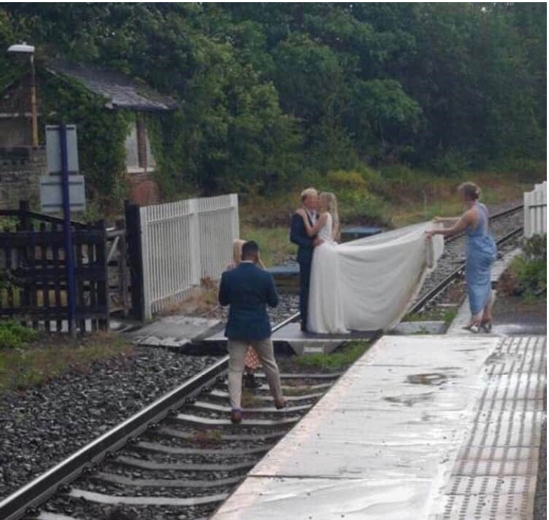 Network Rail has slammed a couple for taking their wedding pictures on the train tracks. Source: Network Rail
