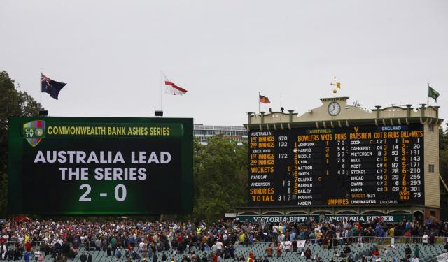 A general view of a board showing the series results and the score board after England lost the second Ashes cricket test against Australia at the Adelaide Oval December 9, 2013. Australia captured England's four remaining wickets before lunch to close out an emphatic 218-run victory in the second Ashes test on Monday. REUTERS/David Gray (AUSTRALIA - Tags: SPORT CRICKET)