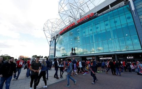 """Soccer Football - Premier League - Manchester United v Leicester City - Old Trafford, Manchester, Britain - August 10, 2018 Fans outside the stadium before the match Action Images via Reuters/Andrew Boyers EDITORIAL USE ONLY. No use with unauthorized audio, video, data, fixture lists, club/league logos or """"live"""" services. Online in-match use limited to 75 images, no video emulation. No use in betting, games or single club/league/player publications. Please contact your account representative for further details - Credit: Action Images"""