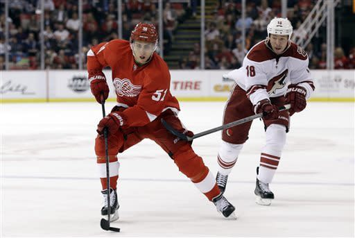 Detroit Red Wings center Valtteri Filppula (51), of Finland, skates past Phoenix Coyotes wing David Moss (18) in the second period of an NHL hockey game in Detroit, Monday April 22, 2013. (AP Photo/Paul Sancya)