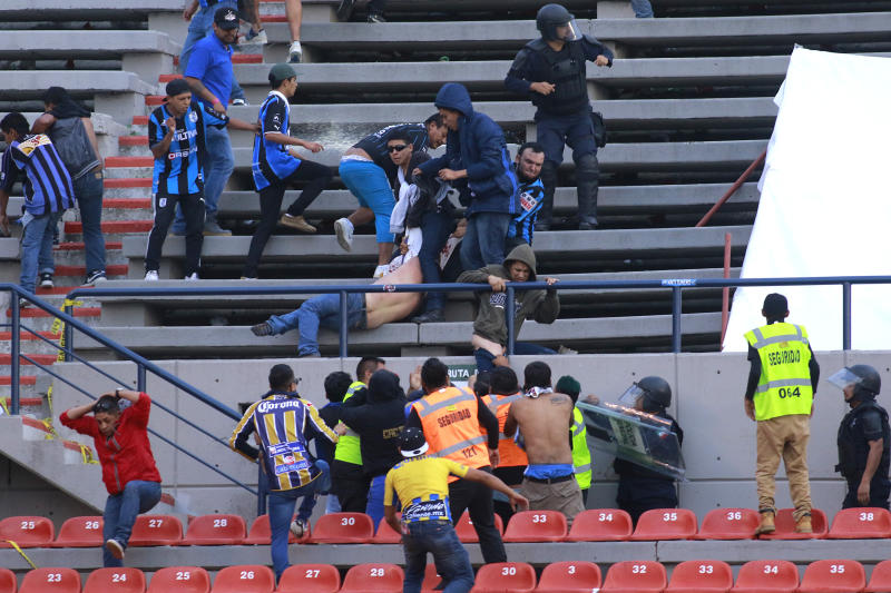SAN LUIS POTOSI, MEXICO - OCTOBER 20: Fans of San Luis and Queretaro fight in the stands during the 14th round match between Atletico San Luis and Queretaro as part of the Torneo Apertura 2019 Liga MX at Estadio Alfonso Lastras on October 20, 2019 in San Luis Potosi, Mexico. (Photo by Cesar Gomez/Jam Media/Getty Images)