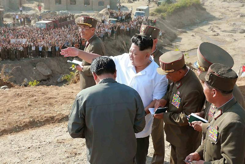 Undated photo North Korean leader Kim Jong-Un (C) visiting Rason City to inspect recovery work in the area hit by floods in August
