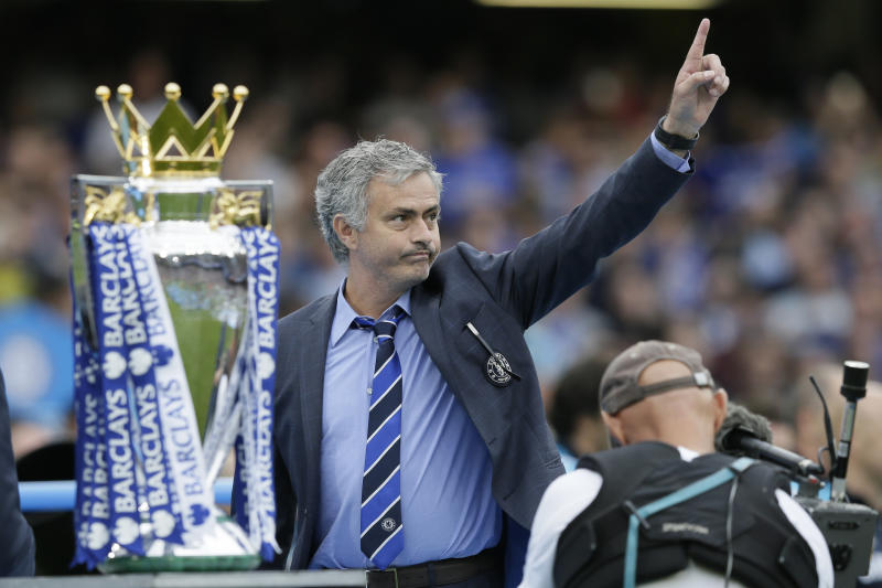 FILE - In this May 24, 2015 file photo Chelsea Manager Jose Mourinho waves to the crowd after the English Premier League soccer match between Chelsea and Sunderland at Stamford Bridge stadium in London. Chelsea were awarded the trophy after winning the English Premier League. Mourinho has left Chelsea with the club languishing one point above the relegation zone just seven months after winning the Premier League title, it was reported on Thursday, Dec. 17, 2015. (AP Photo/Tim Ireland, File)