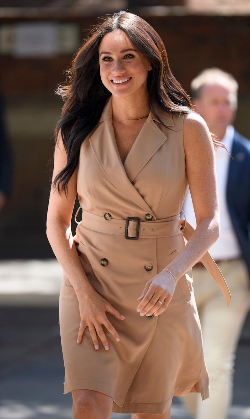 The Duchess of Sussex wore a Banana Republic dress to visit to the University of Johannesburg in October 2019. (Getty Images)