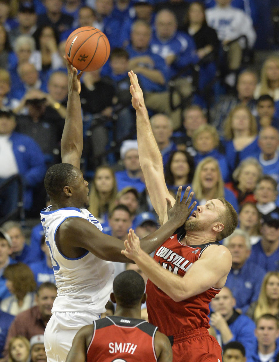 Kentucky's Julius Randle, left, shoots over the defense of Louisville Stephan Van Treese during the first half of an NCAA college basketball game on Saturday, Dec. 28, 2013, in Louisville, Ky. (AP Photo/Timothy D. Easley)
