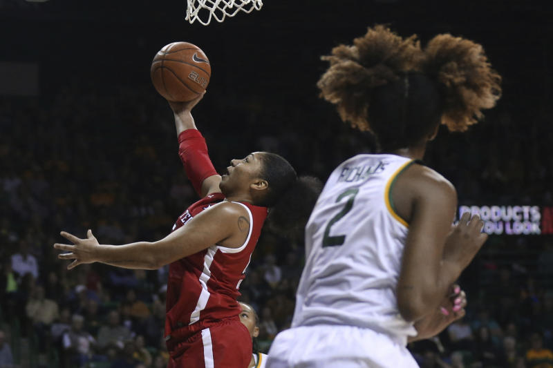 Texas Tech guard Andrayah Adams, left, shoots over Baylor guard DiDi Richards, right, in the first half of an NCAA college basketball game, Saturday, Jan. 25, 2020, in Waco Texas. (AP Photo/Rod Aydelotte)