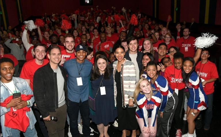 "(L-R) Greg Berlanti, Terayle Hill, Becky Albertalli, Alexandria Shipp and Nick Robinson pose with movie audience members at a ""Love, Simon"" fan screening in Atlanta, Georgia on March 5"