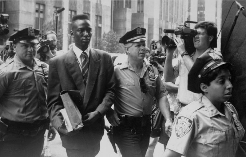 Accused rapist Yusef Salaam is escorted by police.