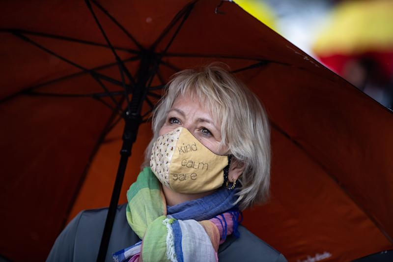 "British Columbia provincial health officer Dr. Bonnie Henry wears a face mask as she views the ""Murals of Gratitude"" exhibition in Vancouver on July 3, 2020. (Photo: Darryl Dyck/THE CANADIAN PRESS)"