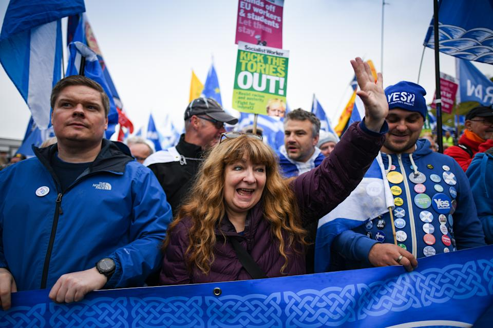 EDINBURGH, SCOTLAND - OCTOBER 05: Comedian Janey Godley joins thousands of people take part in the All Under One Banner march and rally in support for Scottish independence on October 5, 2019 in Edinburgh, Scotland. The organisers were holding their final major rally of the year in the Scottish capital following previous demonstrations in Glasgow, Oban and Aberdeen. (Photo by Jeff J Mitchell/Getty Images)