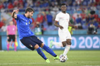 Italy's Manuel Locatelli, left, scores his side's second goal during the Euro 2020 soccer championship group A match between Italy and Switzerland at the Rome Olympic stadium, Wednesday, June 16, 2021. (Alfredo Falcone/LaPresse via AP)