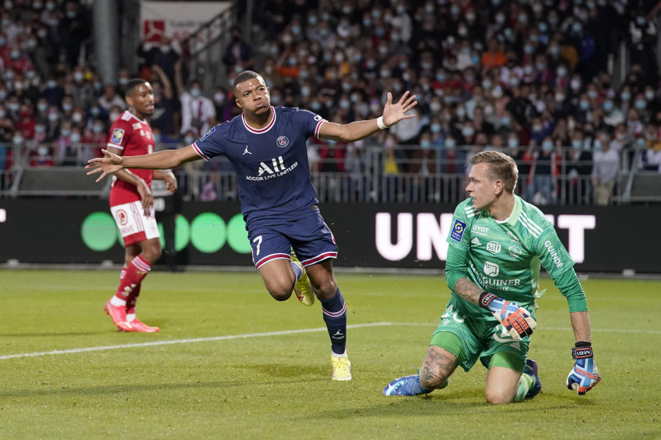 PSG's Kylian Mbappe, left, celebrates after scoring his side's second goal during a French League One soccer match between Brest and PSG at the Francis-Le Ble stadium in Brest, France, Friday, Aug. 20, 2021. (AP Photo/Daniel Cole)