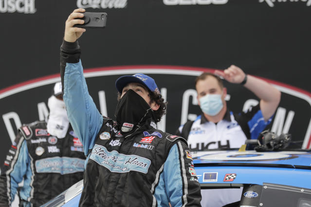 Members of Chase Briscoe's crew celebrate after Briscoe won the NASCAR Xfinity series auto race Thursday, May 21, 2020, in Darlington, S.C. (AP Photo/Brynn Anderson)