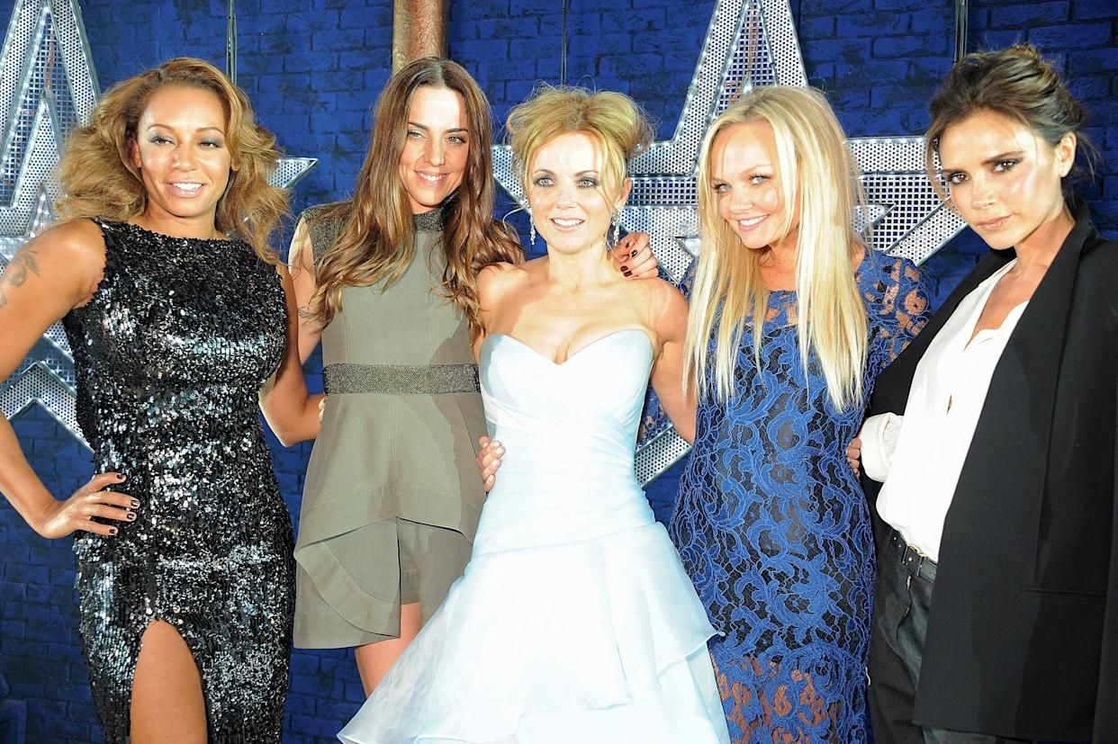 LONDON, ENGLAND - DECEMBER 11:  (EMBARGOED FOR PUBLICATION IN UK TABLOID NEWSPAPERS UNTIL 48 HOURS AFTER CREATE DATE AND TIME. MANDATORY CREDIT PHOTO BY DAVE M. BENETT/GETTY IMAGES REQUIRED)  (L to R) Melanie Brown, Melanie Chisholm, Geri Halliwell, Emma Bunton and Victoria Beckham pose backstage during the Gala Press Night performance of 'Viva Forever' at the Piccadilly Theatre on December 11, 2012 in London, England.  (Photo by Dave M. Benett/Getty Images)