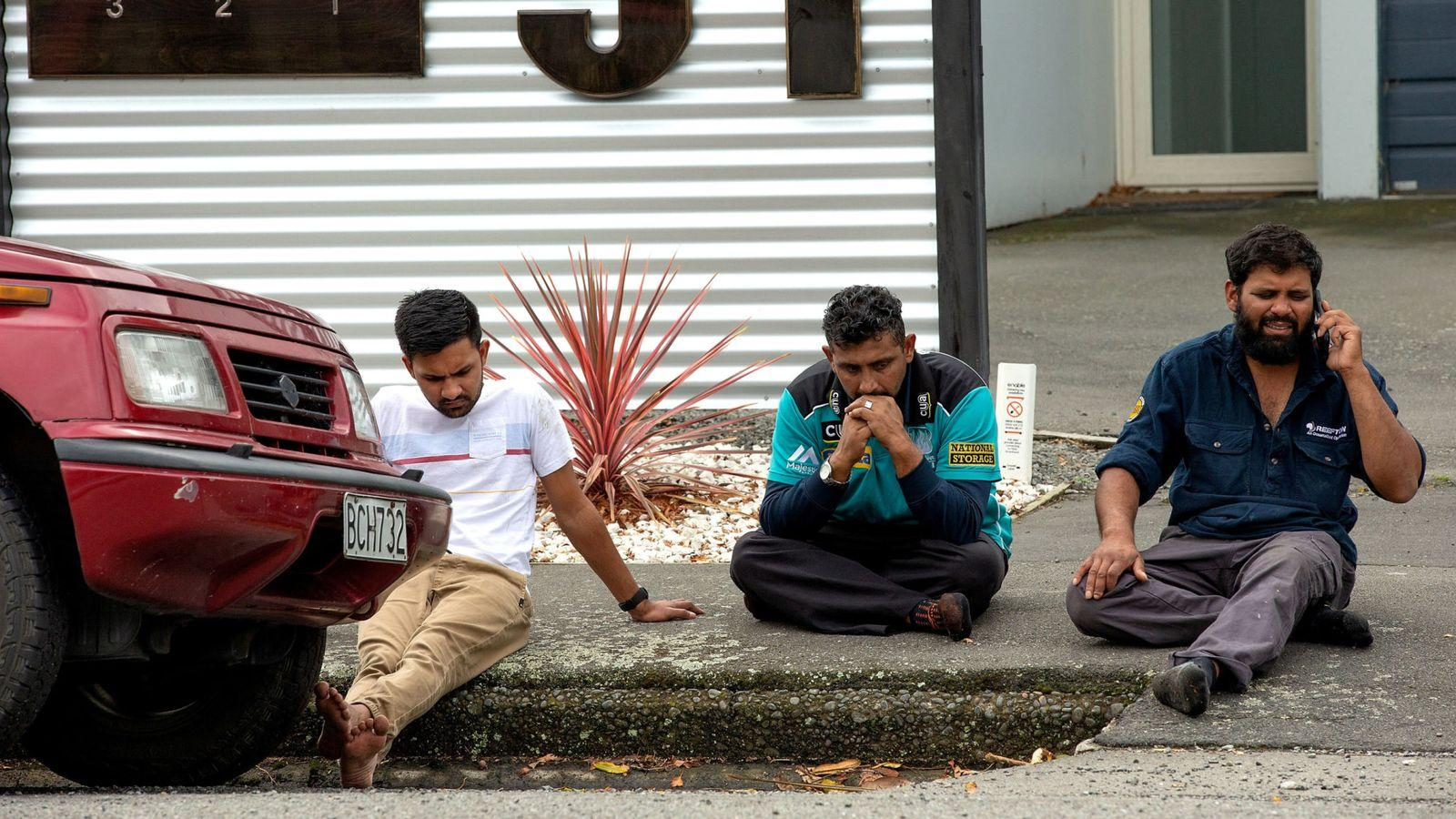 Grieving members of the public following a shooting at the Al Noor mosque