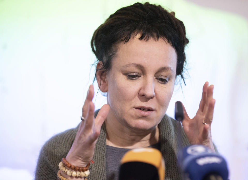 Polish author Olga Tokarczuk gestures during a press conference in Bielefeld, Germany, Thursday, Oct 10, 2019. Tokarczuk has been named recipient of the 2018 Nobel Prize in Literature, Thursday. Two Nobel Prizes in literature were announced Thursday after the 2018 literature award was postponed following sex abuse allegations that rocked the Swedish Academy at that time. (Friso Gentsch/dpa via AP)