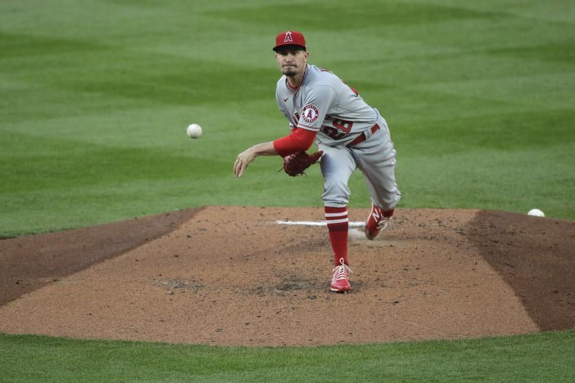 Los Angeles Angels starting pitcher Andrew Heaney throws to a Seattle Mariners batter.