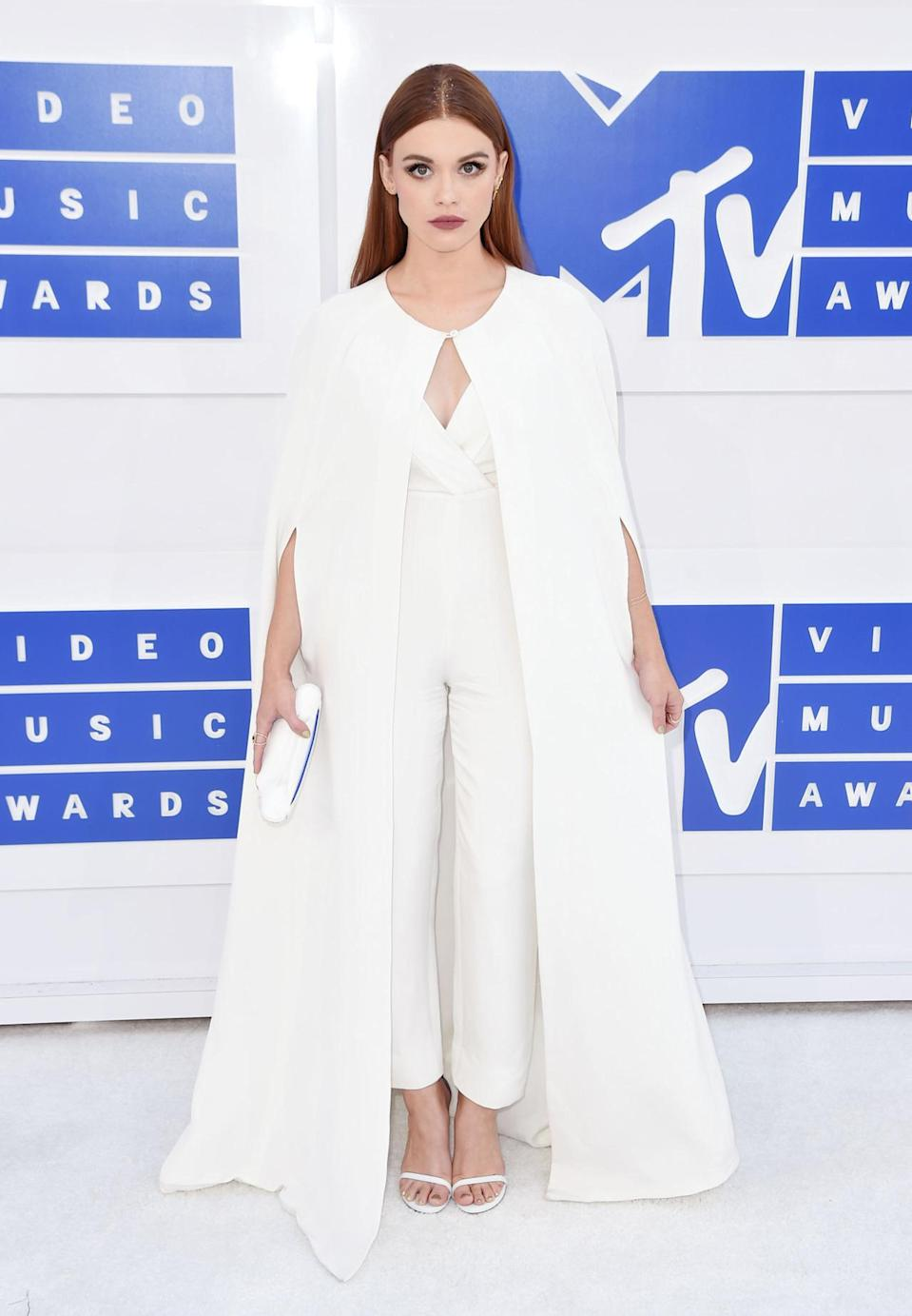 <p>The most popular style on red carpets recently has been rocking a white train — see Katy Perry, Solange Knowles, Lady Gaga, and more. Holland Roden hopped on the train by wearing one with a jumpsuit. <i>(Photo: Getty Images)</i></p>