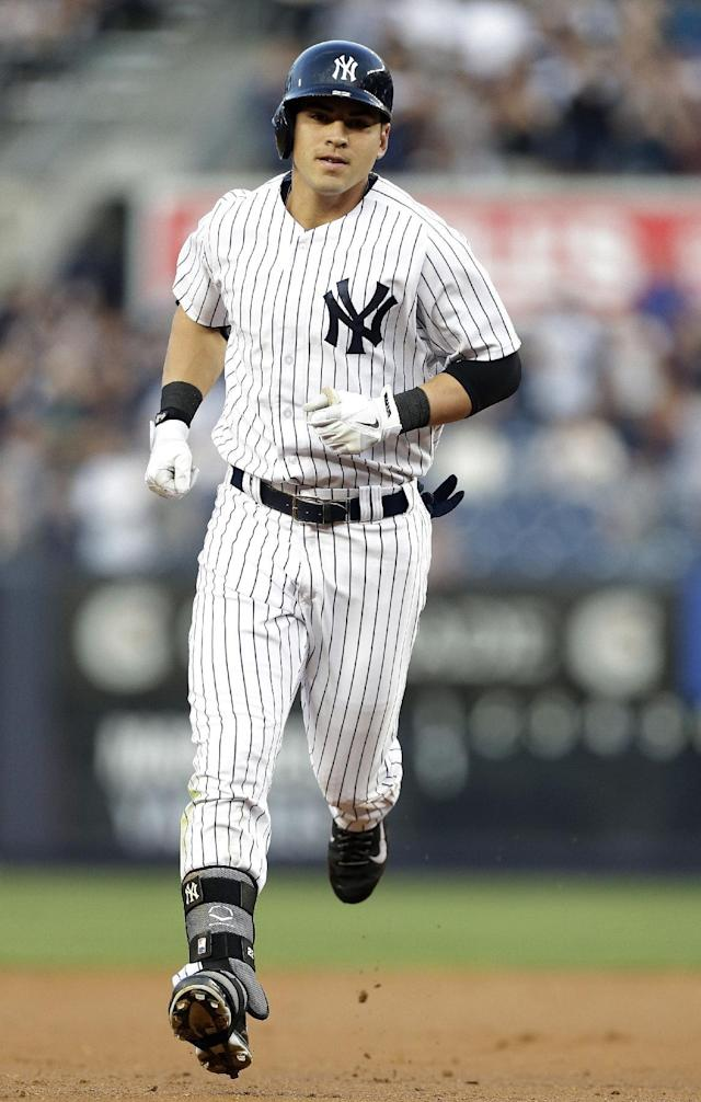 New York Yankees' Jacoby Ellsbury runs the bases after hitting a home run during the first inning of a baseball game against the Seattle Mariners, Thursday, May 1, 2014, in New York. (AP Photo/Frank Franklin II)