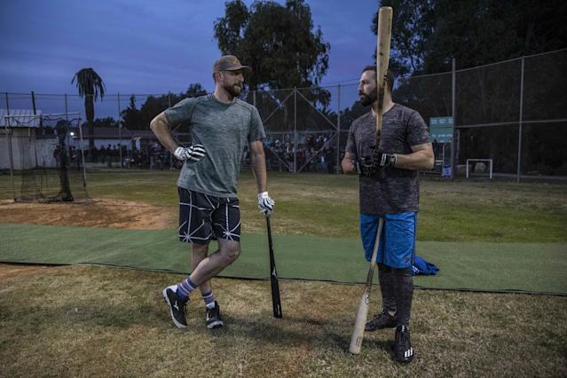 Team Israel's Ike Davis, left, and teammate Cody Decker chat during practice at the Baptist Village sport complex in Israel. (AP)