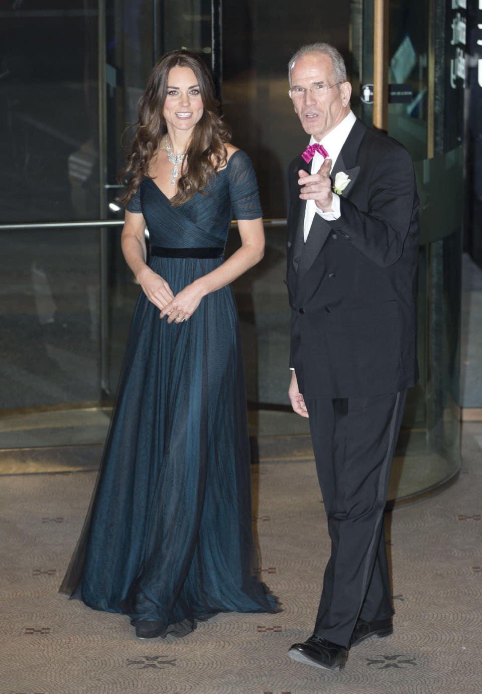 <p>Kate stunned in a demure Jenny Packham gown for the 2014 Portrait Gala in London. Designed in a petrol blue shade, the Duchess turned heads in a diamond necklace loaned to her by the Queen.</p><p><i>[Photo: PA]</i></p>