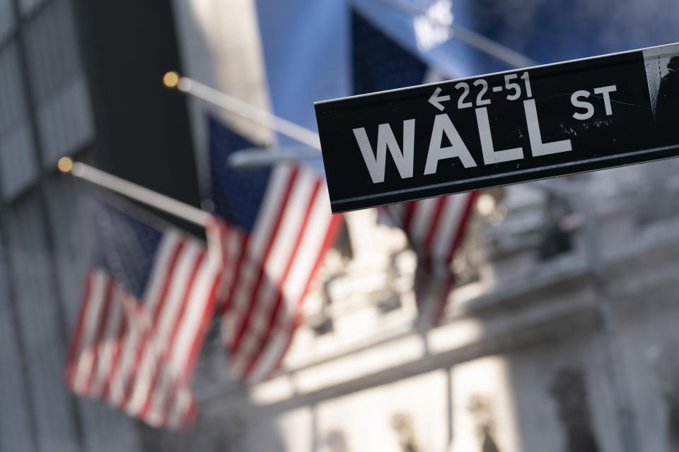 A Wall Street sign hangs outside the New York Stock Exchange on July 8, 2021. Stocks are down slightly on Wall Street early in trading on Tuesday, August 31, 2021, a day after the S&P 500 and Nasdaq hit their last record highs.  The S&P 500 slipped 0.2% and the Nasdaq fell 0.3%.  Traders are keeping an eye on a final trickle of corporate profits and look to Friday, when the Labor Department releases its monthly jobs report.  (AP Photo / Mark Lennihan, file)