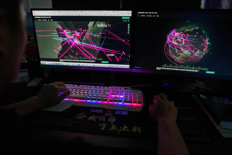 Prince, a member of the hacking group Red Hacker Alliance who refused to give his real name, uses a website that monitors global cyberattacks on his computer at their office in Dongguan.