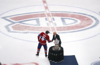 Montreal Canadiens' Shea Weber (6) is presented with the Clarence Campbell trophy by Bill Daly after the team's victory in overtime of Game 6 of an NHL hockey Stanley Cup semifinal playoff series against the Vegas Golden Knights Thursday, June 24, 2021 in Montreal. (Paul Chiasson/The Canadian Press via AP)