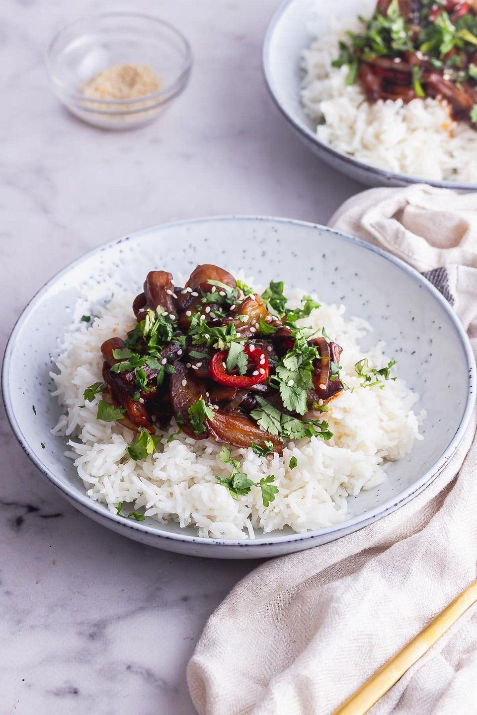 """<p>This recipe features a spicy stir fried aubergine that's made with a sticky soy sauce glaze and thinly sliced onion and chilli. The aubergine is cooked until super tender and served over rice.</p><p>Get the <a href=""""https://thecookreport.co.uk/stir-fried-aubergine/"""" rel=""""nofollow noopener"""" target=""""_blank"""" data-ylk=""""slk:Stir Fried Aubergine with Chilli"""" class=""""link rapid-noclick-resp"""">Stir Fried Aubergine with Chilli</a> recipe.</p><p>Recipe from <a href=""""https://thecookreport.co.uk/"""" rel=""""nofollow noopener"""" target=""""_blank"""" data-ylk=""""slk:The Cook Report"""" class=""""link rapid-noclick-resp"""">The Cook Report</a>. </p>"""