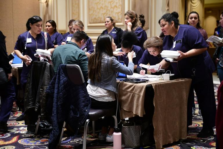 Workers at Las Vegas's luxurious Bellagio hotel checked in before taking part in Nevada's caucuses (AFP Photo/FREDERIC J. BROWN)