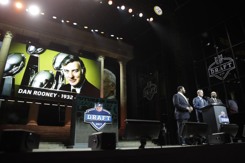 NFL commissioner Roger Goodell, center, and former Pittsburgh Steelers' Jerome Bettis, left, and Franco Harris pay tribute to Dan Rooney during the first round of the 2017 NFL football draft, Thursday, April 27, 2017, in Philadelphia. (AP Photo/Matt Rourke)