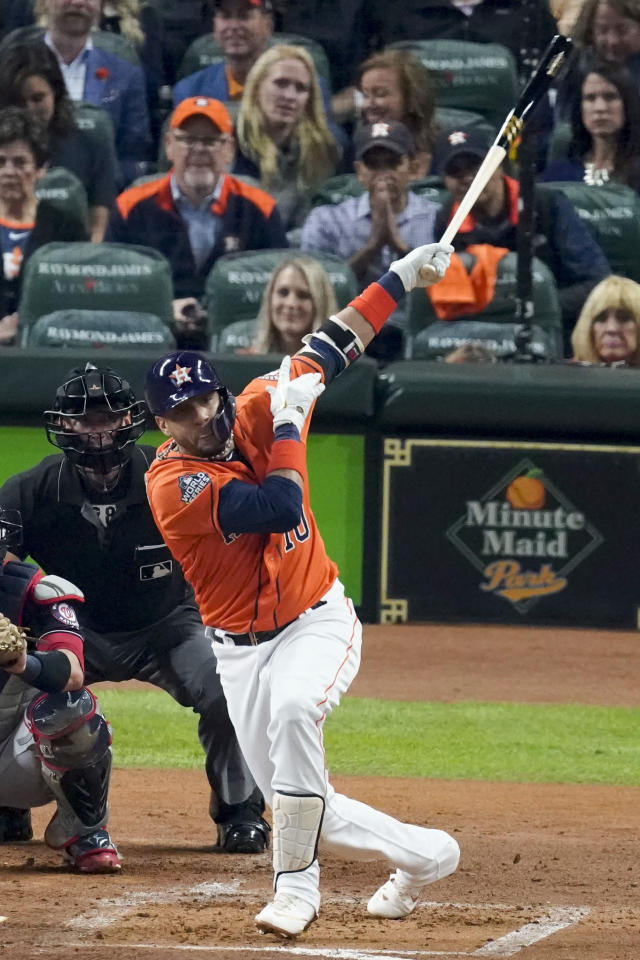 Houston Astros' Yuli Gurriel hits home run against the Washington Nationals during the second inning of Game 7 of the baseball World Series Wednesday, Oct. 30, 2019, in Houston. (AP Photo/Eric Gay)