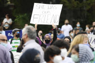<p>A young woman holds a sign as she attends a vigil outside the London Muslim Mosque for the victims of the deadly vehicle attack on five members of the Canadian Muslim community in London, Ont., on Tuesday, June 8, 2021. Four of the members of the family died and one is in critical condition. Police have charged a London man with four counts of murder and one count of attempted murder. THE CANADIAN PRESS/Nathan Denette</p>