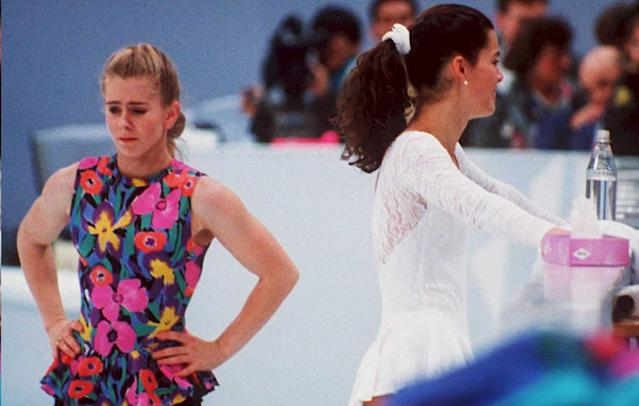 Tonya Harding (L) and Nancy Kerrigan (R) at an event one month after the infamous attack on Kerrigan. (Getty)