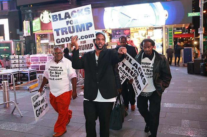 Black supporters of Donald Trump make their way through Times Square, Nov. 9, 2016. (Photo: Gordon Donovan/Yahoo News)