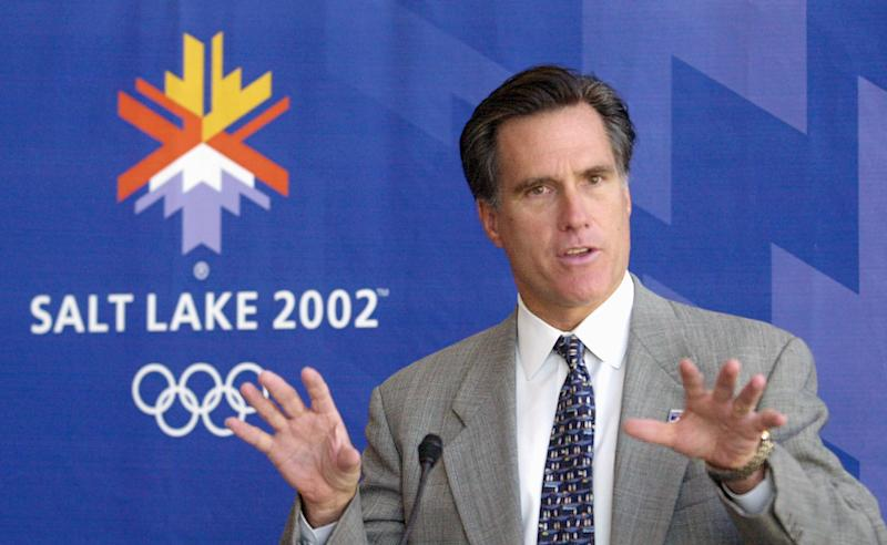 FILE - In this Oct. 1, 2001, file photo Mitt Romney, president of the Salt Lake Organizing Committee, announces there are 70,000 additional tickets available for purchase for the 2002 Winter Games during a news conference in Salt Lake City. Romney will put his time running the Olympics back in the spotlight Saturday, Feb. 18, 2012, when he speaks at a major celebration honoring the 10-year anniversary of the games.  (AP Photo/Douglas C. Pizac, File)