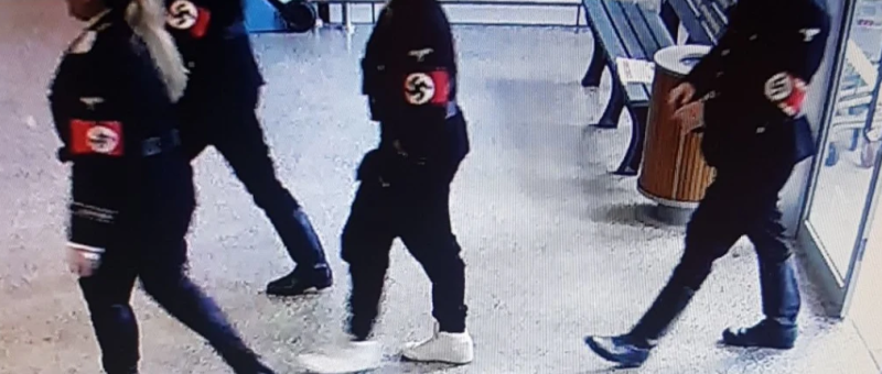 Four people dressed in Nazi uniforms seen entering a supermarket.